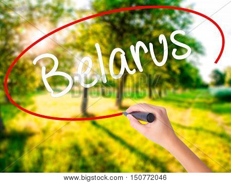 Woman Hand Writing Belarus  With A Marker Over Transparent Board .