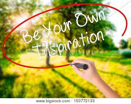 Woman Hand Writing Be Your Own Inspiration With A Marker Over Transparent Board .