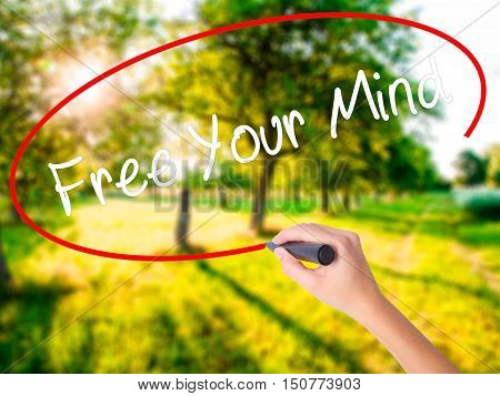 Woman Hand Writing Free Your Mind With A Marker Over Transparent Board