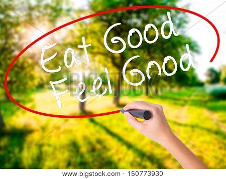 Woman Hand Writing Eat Good Feel Good With A Marker Over Transparent Board