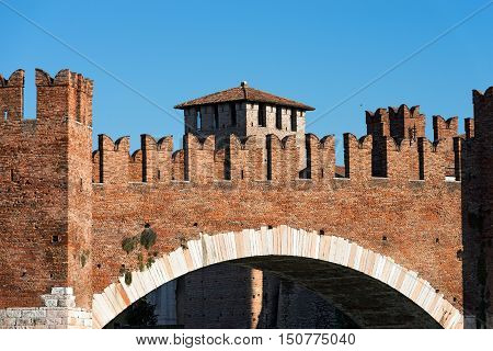 Detail of the ancient Scaligero bridge near Castelvecchio (Old Castle) with Ghibelline battlements in Verona (UNESCO world heritage site) - Veneto Italy