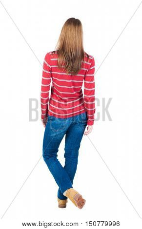 back view of standing young beautiful  blonde woman in jeans. girl  watching. Rear view people collection.  backside view of person.  Isolated over white background. Throwing his legs blonde in a