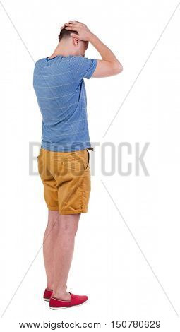 Back view of angry young man in shorts and t-shirt. Rear view. isolated over white. backside view of person.  Rear view people collection. Isolated over white background.