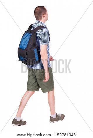 back view of walking man with backpack.  brunette guy in motion. backside view of person.  Rear view people collection. Isolated over white background. young man goes to side of a rolling travel bag