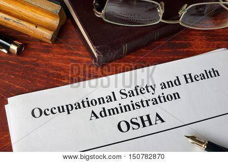 Occupational Safety and Health Administration  OSHA  and a book.