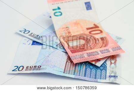 European Union banknotes  on white background. Euro currency.  Euro banknote  20 Euro. 10 Euro bills.