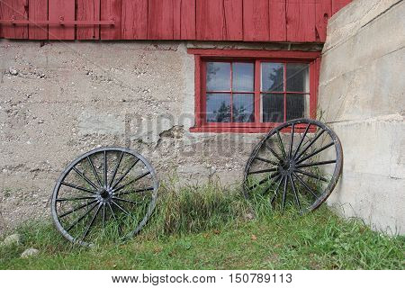 Two wagon wheels leaning against a wall in Sleeping Bear Dunes National Lakeshore, Michigan
