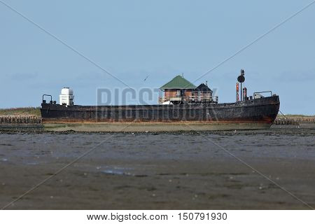 A ship in the North Sea on a sandbank
