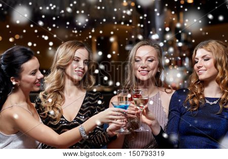 celebration, friends, new year, christmas and winter holidays concept - happy women drinking champagne and cocktails at bachelorette party at night club over snow