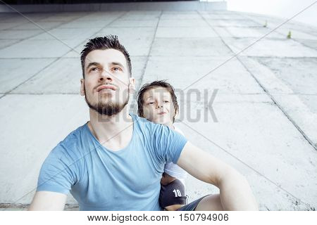 mature father with his son under the bridge having fun together happy family, lifestyle people concept close up
