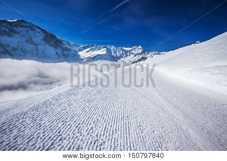 View to Ski slopes with the corduroy pattern in Elm ski resort Swiss Alps Switzerland