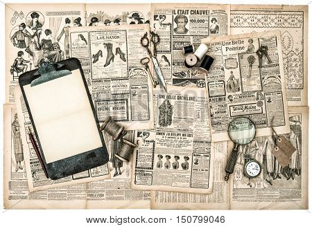 Antique accessories sewing and writing tools old fashion magazine for the woman. Vintage style toned picture