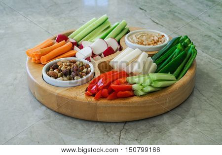 Vegetable Crudites and Dips/ vegetable vegan raw platter with nuts and hummus dip, healthy eating. Toning. Selective focus