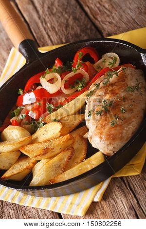 Sizzling Chicken With Roasted Potatoes And Pepper Close-up On A Pan. Vertical