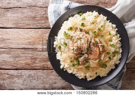Yassa Chicken With Onions And Garnished With Couscous Closeup. Horizontal Top View
