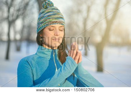 Serene lady relaxing and meditating doing yoga poses