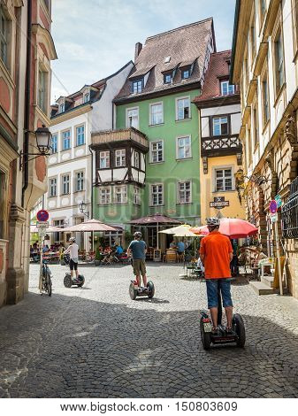 Bamberg Germany - May 22 2016: Riders at sightseeing segway tour in the UNESCO world heritage town Bamberg Germany .