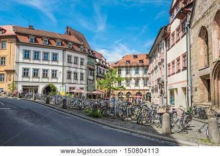 Bamberg Germany - May 22 2016: Pubic bicycle parking station with countless bikes standing lined up in the UNESCO world heritage town Bamberg Germany .