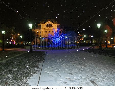 Singing fountain on Main street in Kosice, Slovakia at snaw winter night