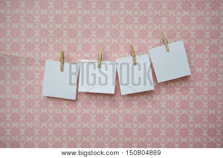 White Sheets Of Paper On A Pink Background, White Sheets On Clothespins
