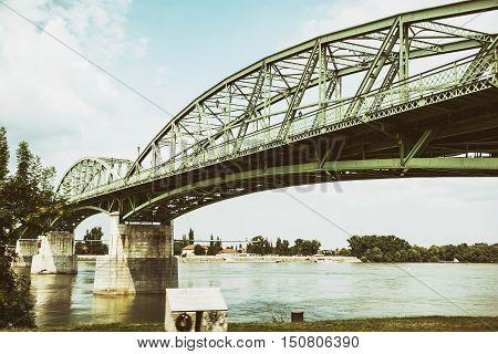 Maria Valeria bridge joins Esztergom in Hungary and Sturovo in Slovak republic across the Danube river. Transportation theme. Architectural scene. poster