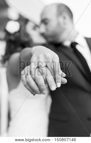 Newly Wedding Couple Place Their Hands Together Showing Off Their Wedding Rings. Selective Focus On