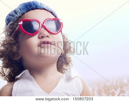 Smiling Child With Red Sun Glasses