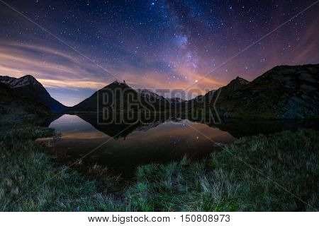 The Outstanding Beauty Of The Milky Way Arc And The Starry Sky Reflected On Lake At High Altitude On