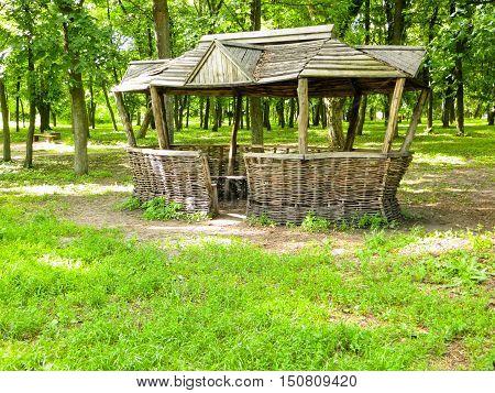 Old wooden gazebo in a green park