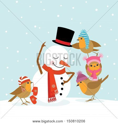Funny Robin birds making a cute snowman.
