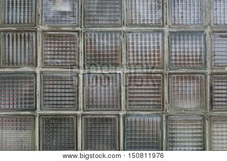 Detailed view of an old wall built of glass bricks.