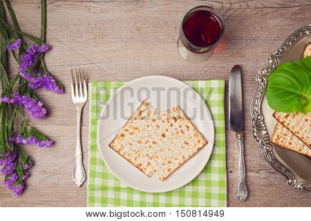 Passover (pesah) holiday table setting with seder plate and matzoh. View from above