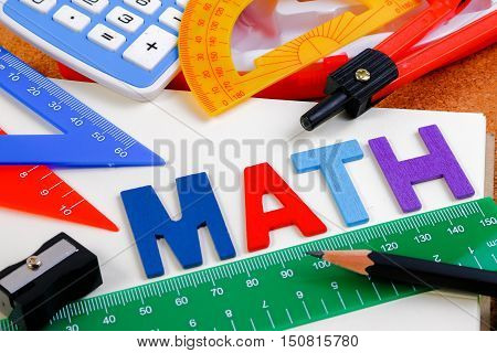 School Math Office Supplies. Wood Letters As Math Word With Mathematics Drawing Icon. Math Concept.