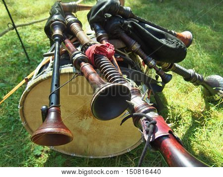 The composition of musical instruments - bagpipes lying on a drum