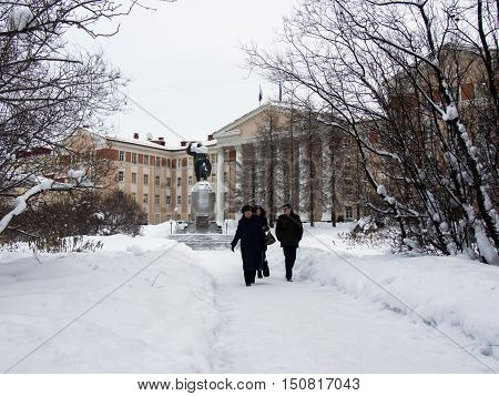 Murmansk, Russia - January 28, 2015: People walk through the park from the Kirov during the polar day.