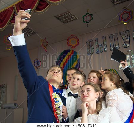 Gagjievo, Russia - October 23, 2015: Students at the celebration of the last call made group photo.
