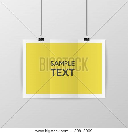 Sheet of paper folded in two, hangs on the clamps. Vector EPS10 illustration.