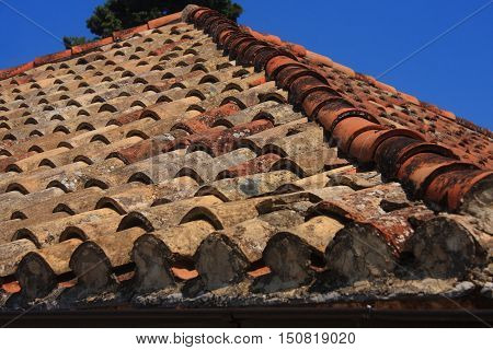 Old damaged roof with clay tiles in Stari Grad on the Croatian island of Hvar