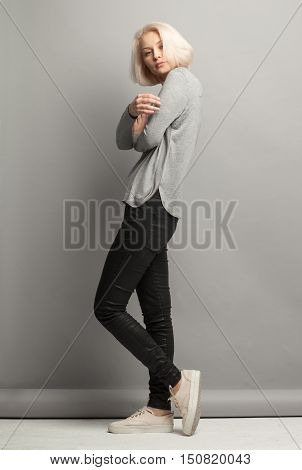 Blonde Woman On Gray Background