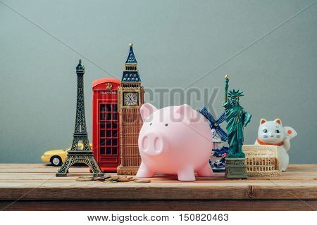 Planning summer vacation money budget trip concept with piggy bank.