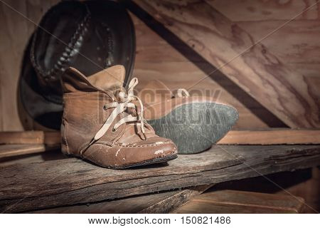 Old boots in the barn. vintage style.