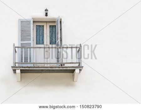 House with balconies and balcony railings with doors