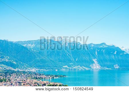 Landscape view on Geneva lake with beautiful mountains and Lausanne city in Switzerland