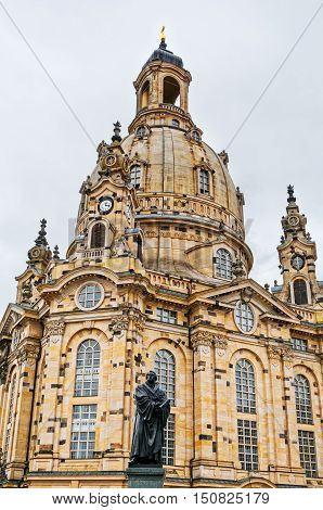 DRESDEN GERMANY- JUNE 20 2016: Frauenkirche (Church of Our lady) and statue of Martin Luther at Neumarkt Square