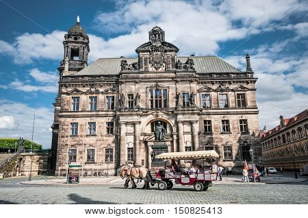DRESDEN GERMANY- JUNE 20 2016: Building of the Court of Appeal and horse carriage