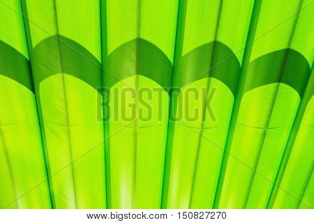 Fragment of green canvas striped marquee roof