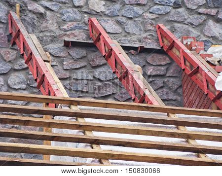 The roof construction with the wooden boards