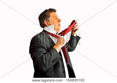 business man in suit binding his tie