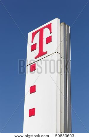 Flensburg, Germany - June 4, 2016: Deutsche Telekom sign on a panel. Deutsche Telekom is a German telecommunications company headquartered in Bonn