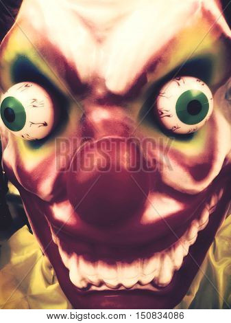 Close up of a scary clown face
